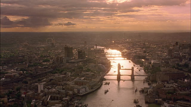 aerial looking west over river thames at dusk / london - river thames stock videos & royalty-free footage