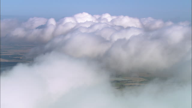 aerial low clouds over countryside near st. andrews / perth and kinross, scotland - st. andrews scotland stock videos & royalty-free footage