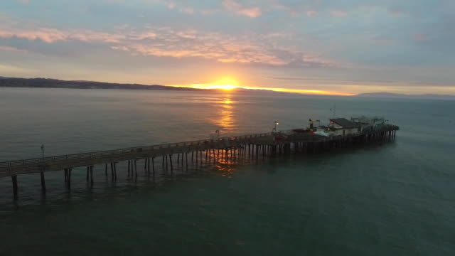 aerial low pan: morning light at capitola pier - santa cruz california stock videos and b-roll footage