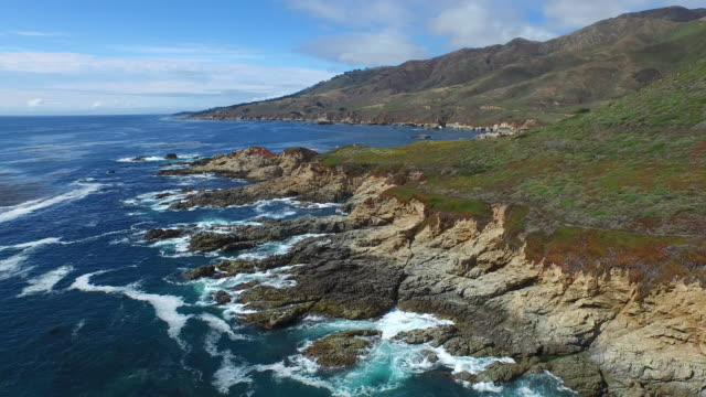 aerial low reverse: 4k uhd waves crashing on rocks near garrapata sp - carmel california stock videos and b-roll footage