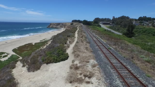 aerial low rise up: railroad tracks near davenport beach to downtown - santa cruz california stock videos and b-roll footage