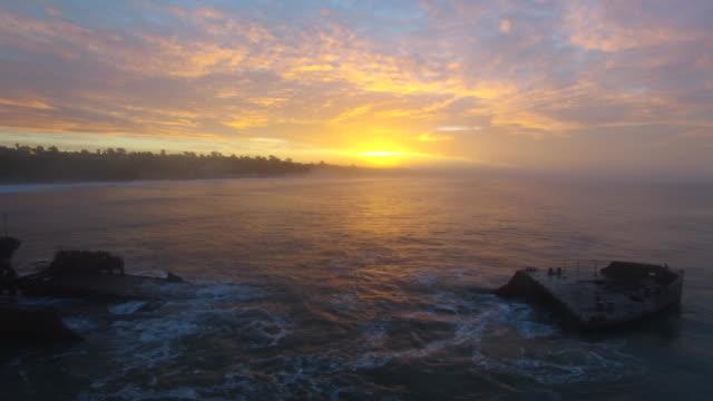 Aerial Low Slow Track Left: 4K UHD Shipwreck Sunrise