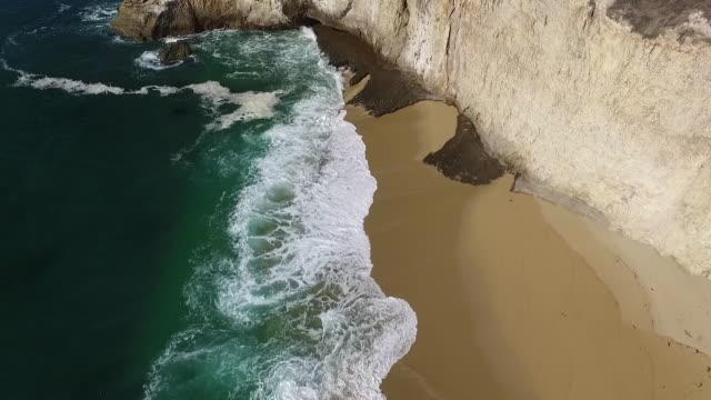aerial low tilt down: bonny doon cliffs - ledge stock videos & royalty-free footage