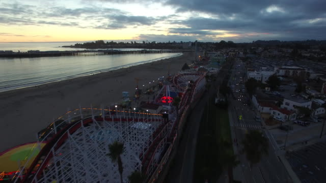 aerial low track & rise: 4k uhd giant dipper at the santa cruz beach boardwalk - santa cruz california stock videos and b-roll footage