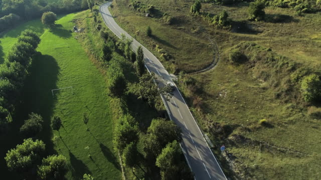 vidéos et rushes de aerial, lush countryside road - spain