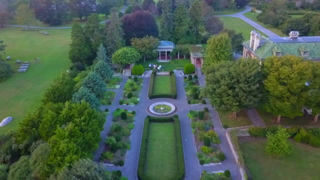 aerial: lush green garden and mansion harkness memorial state park - history stock videos & royalty-free footage