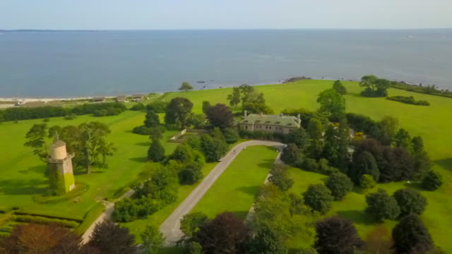aerial: mansion and water tower by the ocean harkness memorial state park - connecticut stock videos & royalty-free footage