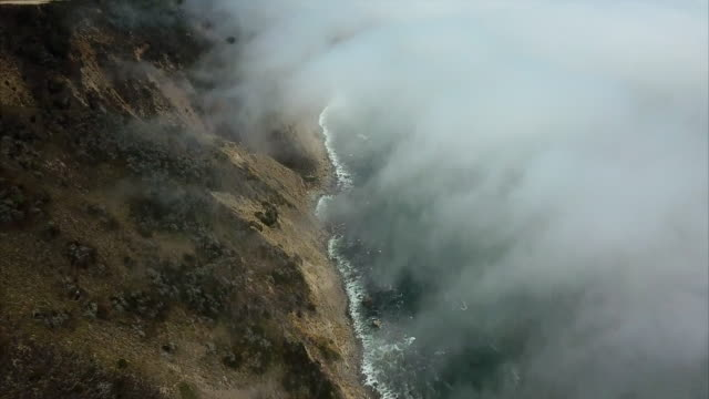 aerial: massive misty clouds near highway 1 and santa lucia mountain - big sur, california - route 001 stock videos & royalty-free footage