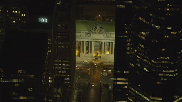 aerial medium approach to fly-over of grand central terminal - ornate stock videos and b-roll footage