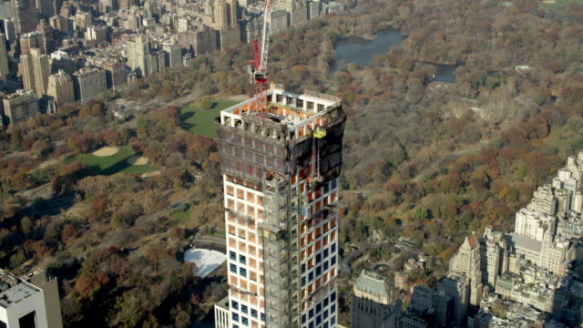 Aerial MEDIUM flyover 432 Park Avenue under construction