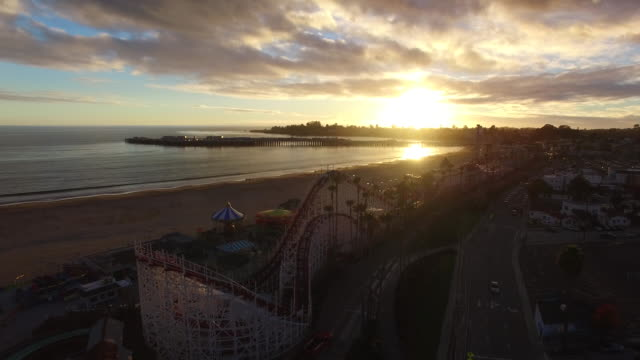aerial medium pan: 4k uhd giant dipper at the santa cruz beach boardwalk - santa cruz california stock videos and b-roll footage