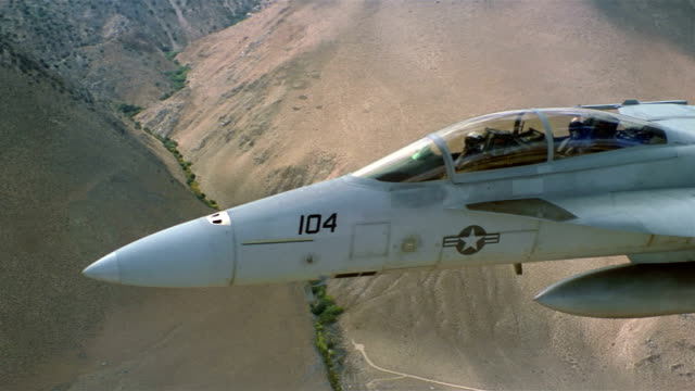 aerial medium shot navy pilots flying two-seat f/a-18 super hornet over hills / california - pilot stock videos & royalty-free footage