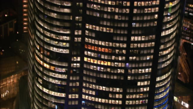 aerial medium shot tilt up windows of mori tower/ tokyo / november 16, 2005 - roppongi hills stock videos and b-roll footage