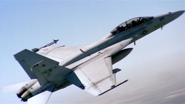 aerial medium shot two-seat f/a-18 super hornet in ascent / california - fighter plane stock videos & royalty-free footage
