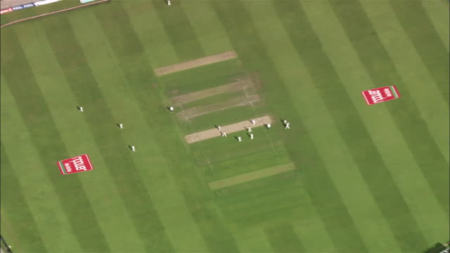 aerial medium shot zoom out wide shot overhead view of cricket game at edgbaston cricket ground / birmingham, england - cricket video stock e b–roll
