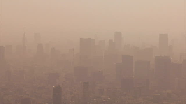 vidéos et rushes de aerial metropolis tokyo environmental city air pollution weather - terre en vue