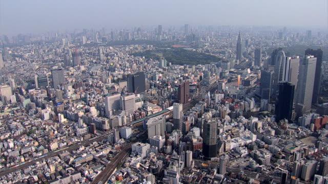 aerial metropolitan skyscrapers business district tokyo rail station - prefettura di tokyo video stock e b–roll