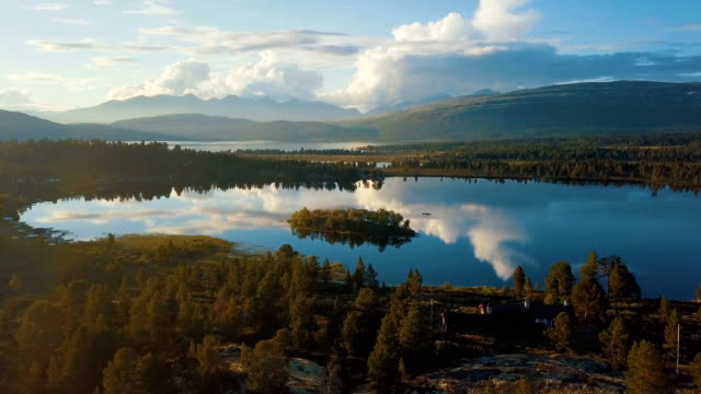 Aerial / midnight sun and beautiful landscape at Rondane national park, Norway
