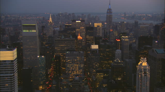 stockvideo's en b-roll-footage met aerial ws midtown from south end of central park looking south down avenues with view of chrysler building, bloomberg tower, metlife building, helmsley building, bear stearns world headquarters, empire state building, and ge building to hampshire house ho - chrysler