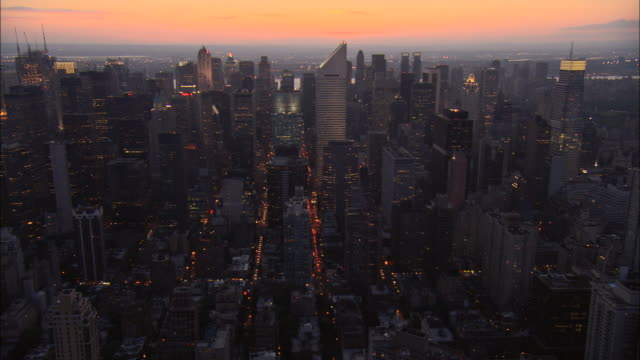 aerial ws midtown streets and traffic with view of citigroup center and bloomberg tower at sunset / manhattan, new york, new york, usa - citigroup center manhattan stock videos & royalty-free footage