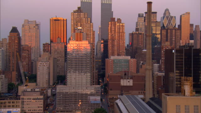 aerial ws midtown west side looking north between 59th and 61st streets with view of time warner center / manhattan, new york, new york, usa - columbus circle stock videos & royalty-free footage