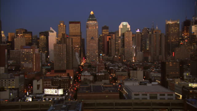 aerial ws midtown west side with view of illuminated buildings including citigroup center, worldwide plaza, general electric building, w hotel, and chrysler building / manhattan, new york, new york, usa - general electric stock videos and b-roll footage