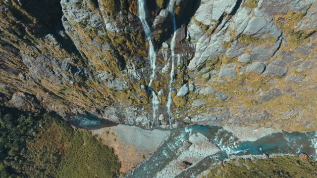 aerial milford sound waterfall - cliff stock videos & royalty-free footage