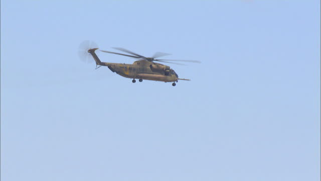 Aerial Military Helicopters flying above the Desert, Arava, Israel