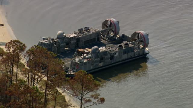 aerial military hovercraft docked on beach / ocean springs, mississippi - 2005年点の映像素材/bロール