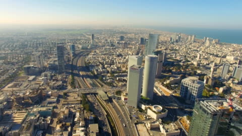 aerial /modern tel aviv with ayalon highway, azrieli towers traffic and ramat gan financial district - テルアビブ点の映像素材/bロール