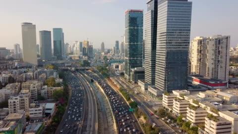 aerial /modern tel aviv with ayalon highway, heavy traffic and ramat gan financial district - テルアビブ点の映像素材/bロール