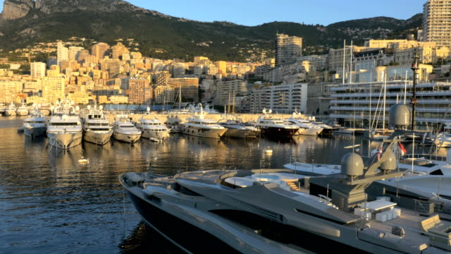 aerial monaco sunset luxury boat marina harbor tourism - monaco stock videos and b-roll footage