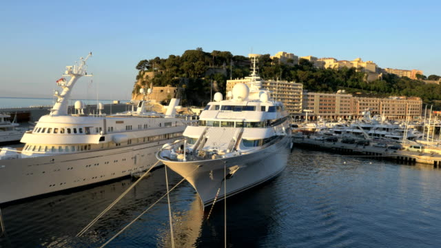 aerial monte carlo sunrise mediterranean pier luxury yacht - monaco stock videos and b-roll footage