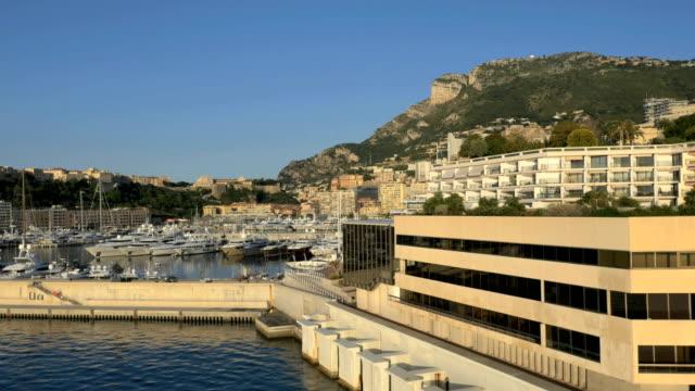 aerial monte carlo sunrise yacht marina harbor travel - aerial transport building stock videos & royalty-free footage