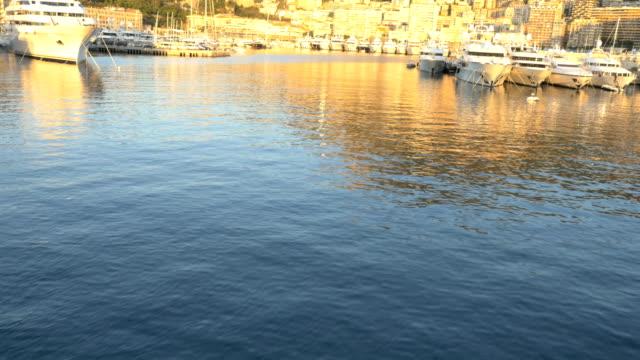 aerial monte carlo sunset mediterranean luxury boat marina - monaco stock videos & royalty-free footage