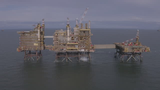 aerial morecambe bay offshore gas field platforms - construction machinery stock videos & royalty-free footage