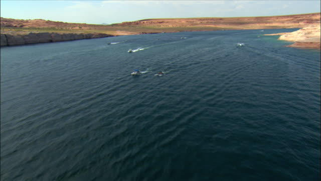 aerial motorboats powering on lake powell - lago powell video stock e b–roll