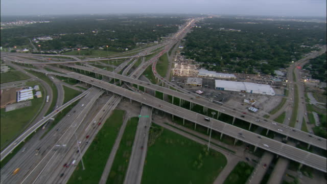 aerial motorway junction with trees and horizon at twilight/ houston, texas - parking stock videos & royalty-free footage