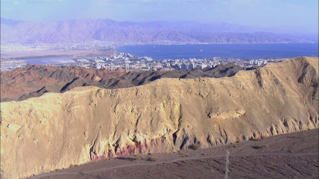 aerial mount solomon and the city of eilat, southern negev, israel, eilat, arava, israel - rotes meer stock-videos und b-roll-filmmaterial