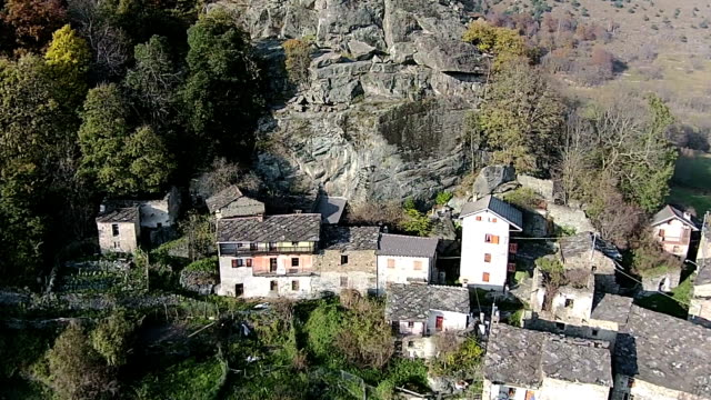 aerial - mountain villages in italian alps - italy stock videos & royalty-free footage