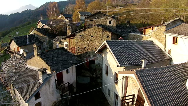 aerial - mountain villages in italian alps - prato stock videos and b-roll footage