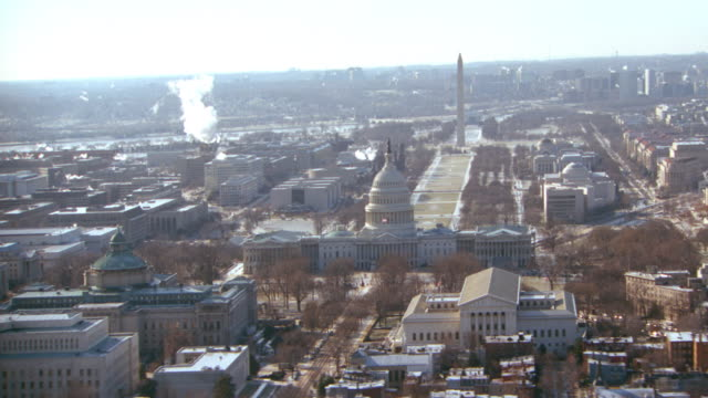 dx - aerial - mov into capitol building - washington d.c. - winter. - winter stock videos & royalty-free footage