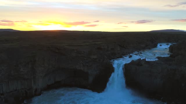 4k aerial move drone flyover aldeyjarfoss waterfall in sunrise scene, summer of iceland - natural column stock videos and b-roll footage