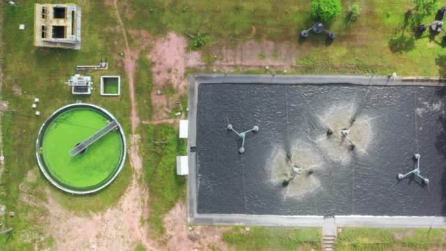 4k aerial movie of sewage treatment plant - concrete stock videos & royalty-free footage