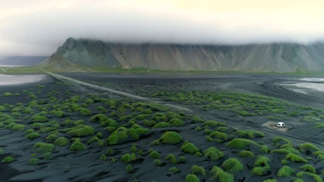 4k aerial movie summer scene of black beach sand and mountain vestrahorn in hofn, iceland - seascape stock videos & royalty-free footage