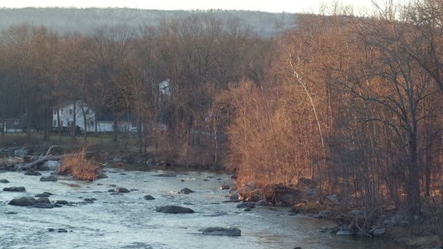 aerial moving along river on winter day in new york - new paltz ny stock videos and b-roll footage