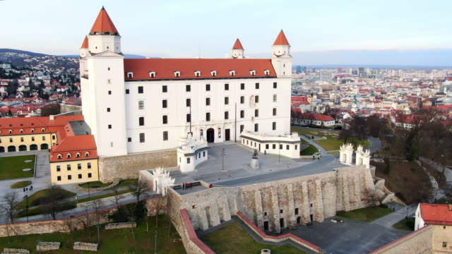 aerial: moving away from bratislava castle facade and entrance in slovakia - dacherker stock-videos und b-roll-filmmaterial