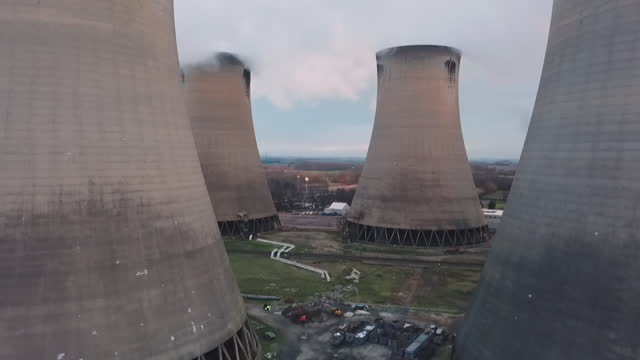 aerial moving between cooling towers at power station - yorkshire england stock videos & royalty-free footage