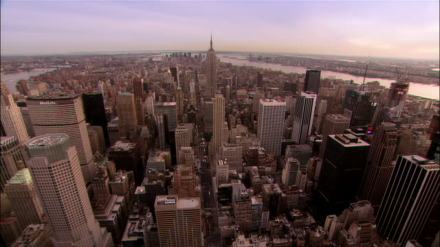 Aerial moving downtown from midtown/ pan north toward Central Park/ New York City
