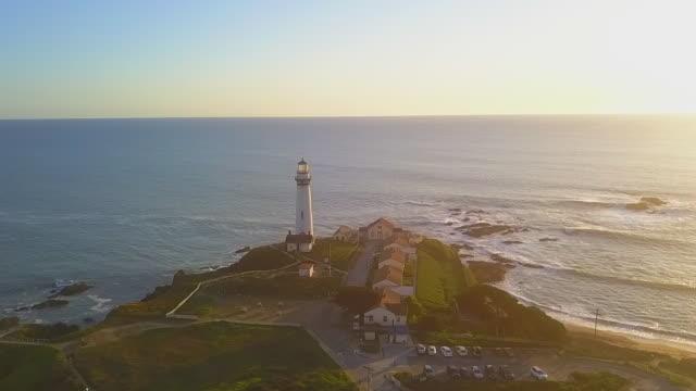 aerial moving: lighthouse on edge of cliff - カリフォルニア州サンタクルーズ点の映像素材/bロール